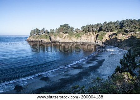 The Pacific Ocean has worn Northern California's coastline into dramatic scenery. Eroded rocks and secluded coves and beaches form impressive vistas that can be viewed from the Pacific Coast highway. - stock photo