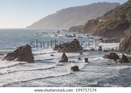The Pacific Ocean has worn Northern California's coastline into dramatic scenery. Highway 1 is built along the coast, allowing drivers to view some of North America's most impressive vistas. - stock photo