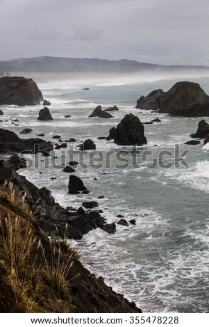 The Pacific Ocean washes against the rugged and beautiful northern California coastline in Mendocino county. This part of California is one of the state's most scenic areas. - stock photo