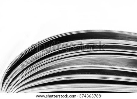 the pages of an open book lit by daylight, macro. black and white photo. copy space - stock photo