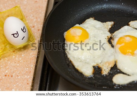 The painted eggs look at cooking eggs in a frying pan