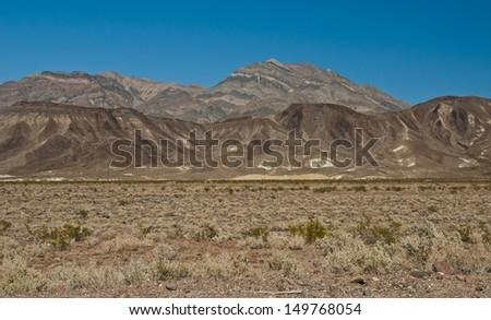 The painted hills of Death valley,against a clear blue sky  - stock photo