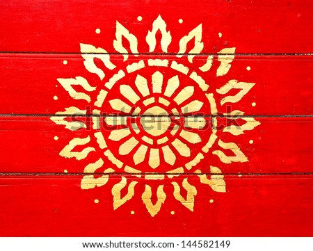 The Painting golden symbol of religion on wood in the  temple.The temple is open to the public and has beautiful murals on the walls.