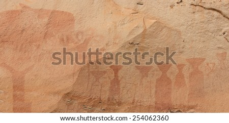 The painting on stone wall be prehistoric drawing age about 3,000 year, at patam of thailand. - stock photo