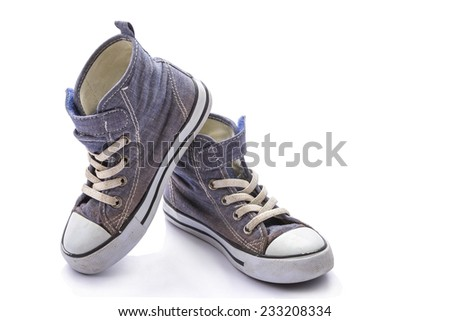 The pair of gray sneakers isolated on white - stock photo