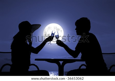 The pair silhouette is held by goblet with wine on a moon night