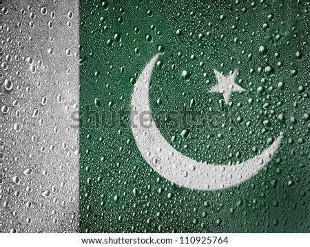 The Pakistani flag painted on metal surface covered with rain drops - stock photo