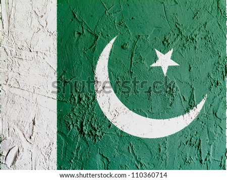 The Pakistani flag painted on wall - stock photo