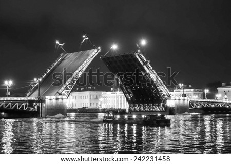 The Palace Bridge is a road traffic and foot bascule bridge spanning the Neva River in Saint Petersburg between Palace Square and Vasilievsky Island in black and white