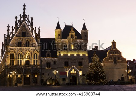 The Palace of the Great Council and the unfinished Gothic Belfry on the Grote Markt in Mechelen, Belgium
