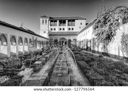 The Palacio de Generalife was the summer palace and country estate of the Nasrid Emirs (Kings) of the Emirate of Granada in Al-Andalus - stock photo