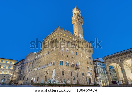 The Palazzo Vecchio (Old Palace) a massive, Romanesque, crenellated fortress-palace, is the town hall of Florence, Italy. - stock photo