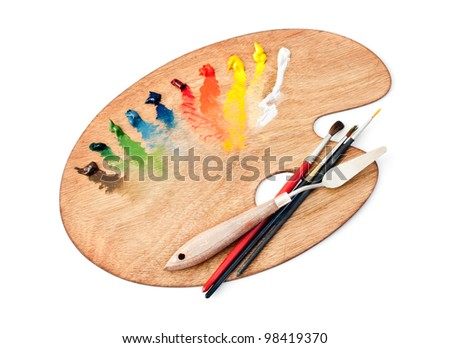 The palette of paints and brushes - stock photo