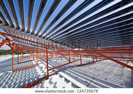 The panel Vacuum solar water heating system on the house roof. - stock photo