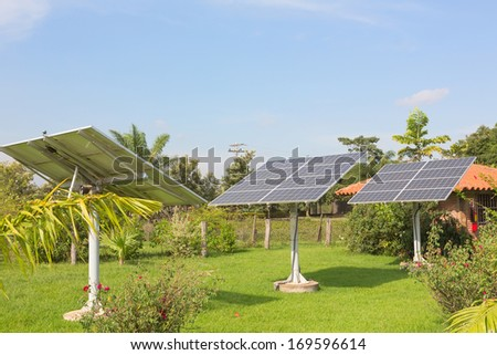 The panels of the solar batteries in the garden - stock photo