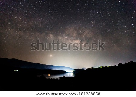 the Panorama Milky Way rises over the dam in Thailand.Long exposure photograph  - stock photo
