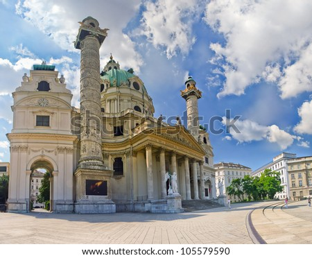 The panorama of an ancient building with statues in rome style. Vienna, Austria. - stock photo
