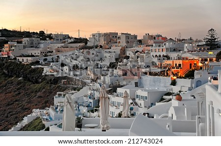 The panorama of Firostefani at sunset on Santorini, Greece