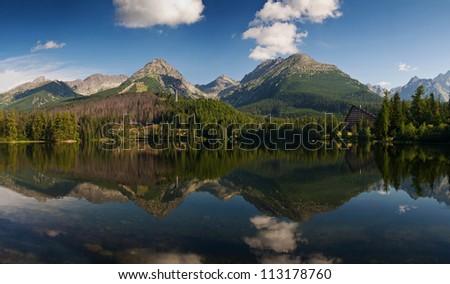 The panorama of mountains reflected in the water-Strbske lake, High Tatras, Carpathian, Slovakia - stock photo