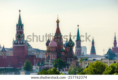 The panorama of the Red Square in Moscow, Russia with St. Basil's Cathedral and Spasskaya (Saviour) Tower - stock photo