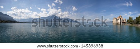 The panorama view of Chillon Castle and Lake Geneva - stock photo