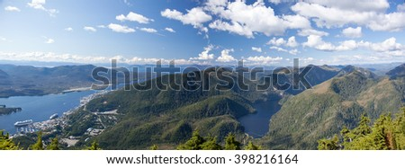 The panoramic view from the top of Deer Mount of Ketchikan town surrounded by mountains (Alaska). - stock photo