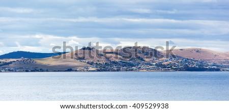 The panoramic view of Hobart town suburbs (Tasmania, Australia). - stock photo