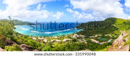 The panoramic view of the island and ocean from above - stock photo