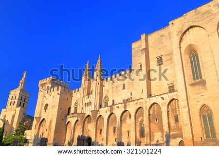 The Papal Palace (Palais des Papes) and Cathedral in the background, Avignon, Provence, France - stock photo
