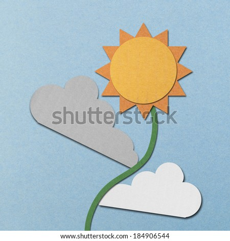 the paper cut of sun and clouds is sunflower on blue sky