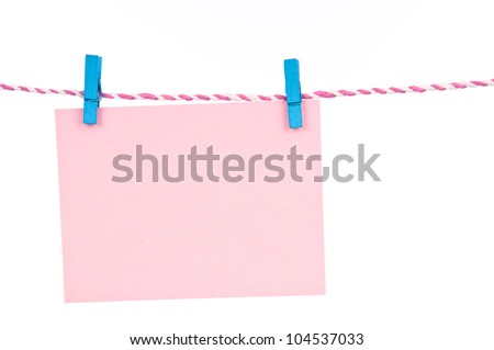 The paper hang with the wooden pin and rope.
