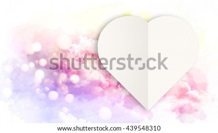 The Paper Heart Cut on Soft clouds in blue sky for background with watercolor techniques,in vivid color. - stock photo