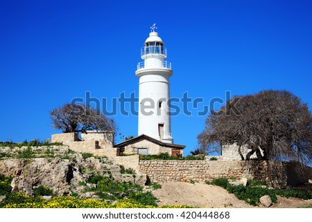 The Paphos lighthouse looking out to the Mediterranean Sea at Paphos, Cyprus, was built in 1888 and stands 20 metres tall - stock photo