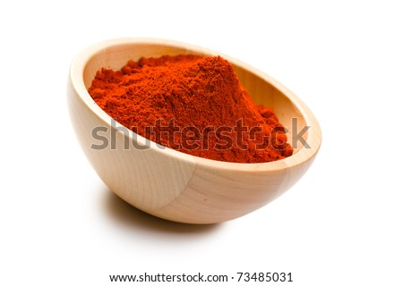 the paprika powder in wooden bowl - stock photo
