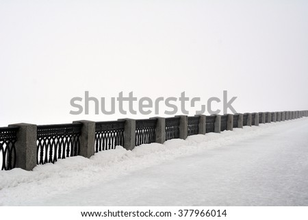 The parapet on the embankment of the Volga river in the winter - stock photo