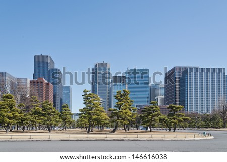 the park at sunny day, buildings near imperial palace in Tokyo City - stock photo