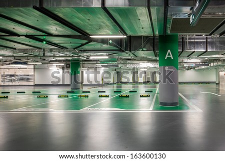 the parking lot was empty and no one,neon light in - stock photo