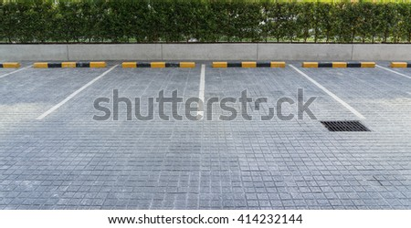 The parking stalls in a parking lot, marked with white lines. - stock photo