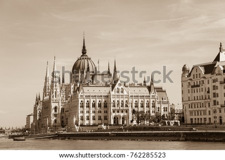 The parliament building of Budapest on the Danube river bank in the Pest area - sepia