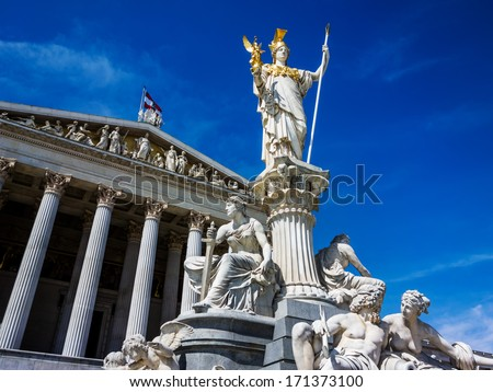 """the parliament in vienna, austria. with the statue of """"pallas athene"""" the greek goddess of wisdom. - stock photo"""