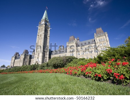 The Parliament of Canada surounded by red flowers, Ottawa - stock photo
