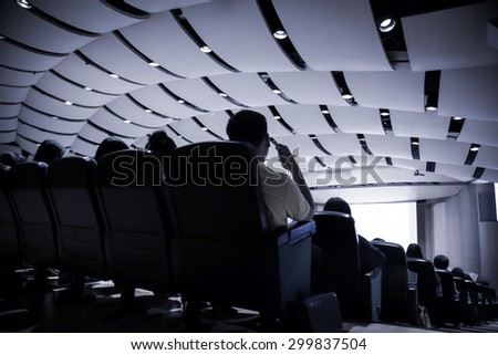 The participants in the auditorium. - stock photo