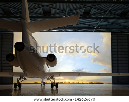 The  passenger aircraft in the hangar. - stock photo