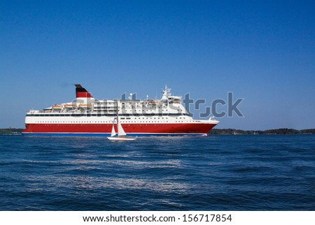 the passenger cruise liner floats by sea by the island
