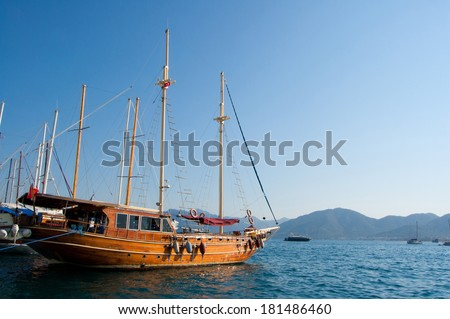 the passenger tourist ship costs at pier of the embankment of the resort town of Marmaris in Turkey
