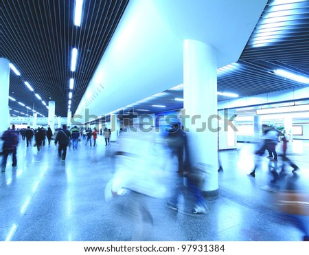 The passengers hastily walking in the Shanghai subway station Silhouettes of people walking by the entrance of modern architecture
