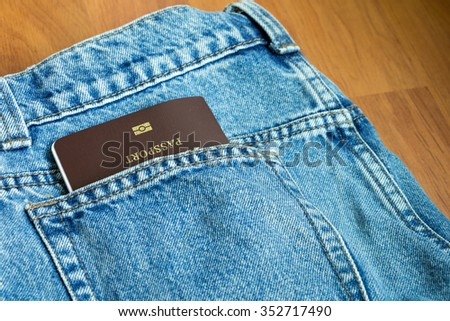 The passport in jeans pants. Prepare to go travel aboard concept. - stock photo