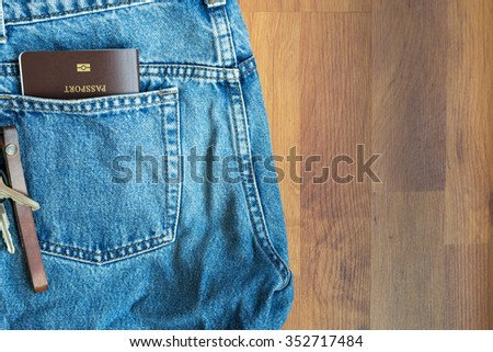 The passport in jeans pants. Prepare to go travel aboard concept. Top view with copy space. - stock photo