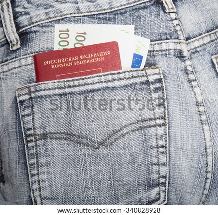 the passport of the citizen of Russia and two notes on hundred euros in a hip-pocket of jeans - stock photo