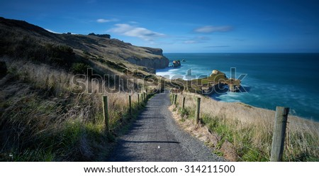 The path down to Tunnel Beach, located in Dunedin, South Island, New Zealand - stock photo